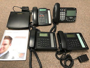 VoIP telephone system with 4 phones and KSU, voicemail
