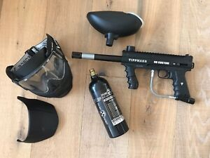 Tippmann 98 Custom Paintball gun with accessories and face mask