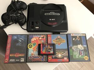 Sega Genesis console w/2 controllers and 5 games.