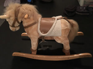 ROCKING HORSE FROM COSTCO..SAYS NEIGH, MOVES HIS HEAD AND TAIL