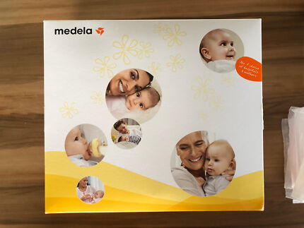 Medela swing breast pump with extras.