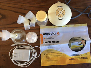 Medela Swing with accessories