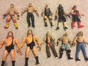 Lot of 24 WWE and WCW figures 1995-2010