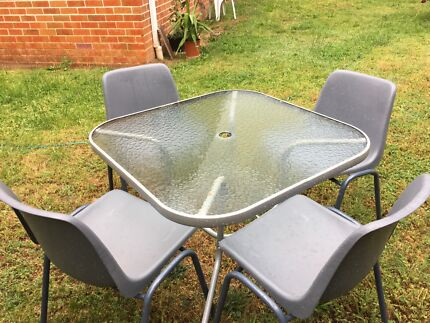 Outdoor glass table with four chairs