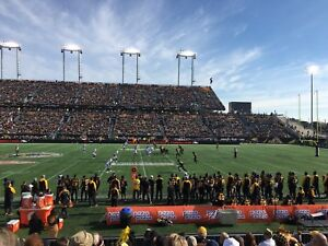Hamilton Tiger-Cats Behind home Bench, 40 yard line, 4 tickets