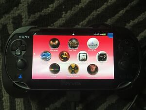 Adult Owned PS Vita with 16GB memory card, 10 games, case & grip