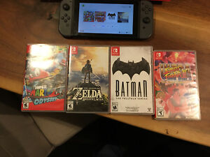 Grey Nintendo Switch with 4 games