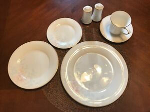 Eight 5 piece China settings with Salt and Pepper Shakers
