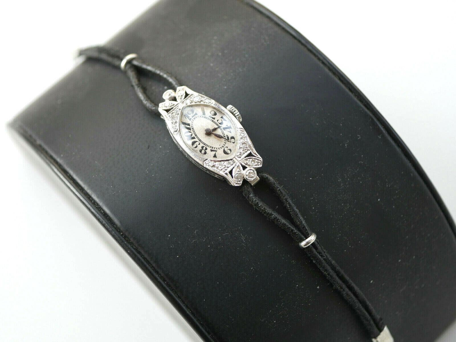 Art Deco Armbanduhr Gehäuse besetzt mit kl. Diamanten in Platin - Handaufzug
