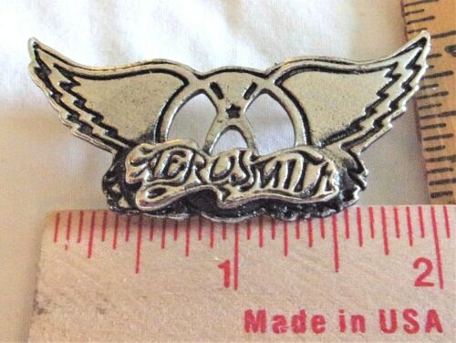 """vintage """"Aerosmith"""" wings pin collectible old rock band concert music pinback"""