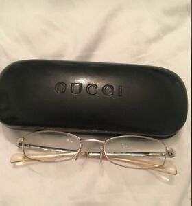 Authentic silver framed gucci eyeglasses with case