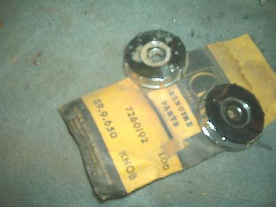 Radio Knob Back Plate, pair.  51-54 Oldsmobile, GM 1 NOS & 1 USED 7260192