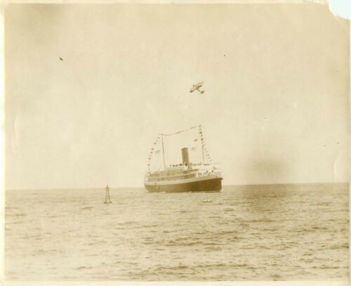 SS Gearida (sp?) Pacific & Orient Stamship coming into Port Bi-Plane over head
