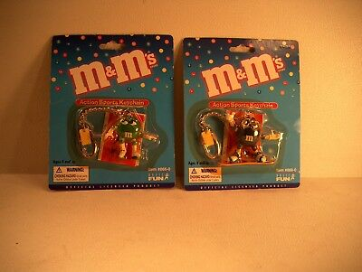 M & M ACTION SPORTS KEYCHAINS / TOTAL OF 2 SEALED - DATED 2000 - BLUE AND GREEN