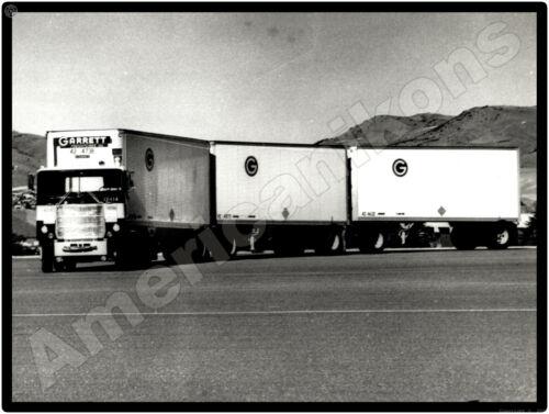 Mack Truck New Metal Sign: Garrett Freight Lines Triple Trailer Rig Pictured