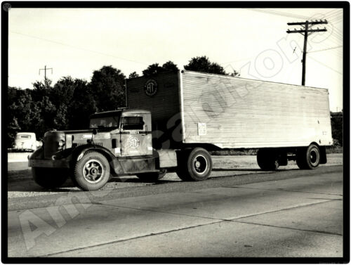 Sterling Trucks New Metal Sign: Associated Transport Tractor Trailer Pictured