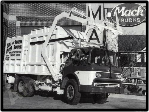 Mack Trucks New Metal Sign: Mack Model N-42 Garbage Truck at Dealership