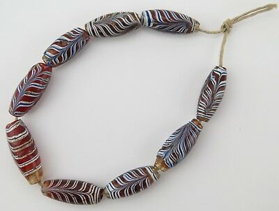 African trade bead strand. Nine Venetian glass 'feathered' beads.