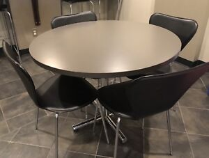 """Round 40"""" dark grey table with chrome base and 4 chairs"""