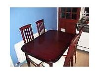 Mahogany dining table and four chairs.