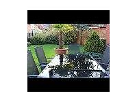 Outside Black Glass Table and 6 Black and Grey Chairs