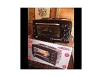 Mini Oven/Hob 2700W Hobs seperate controls Hardly used. Rotisserie option as well.