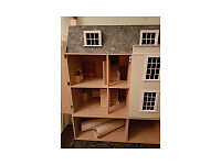 large wooden dolls house with basement attachment. Also included is a full electrical lighting kit .