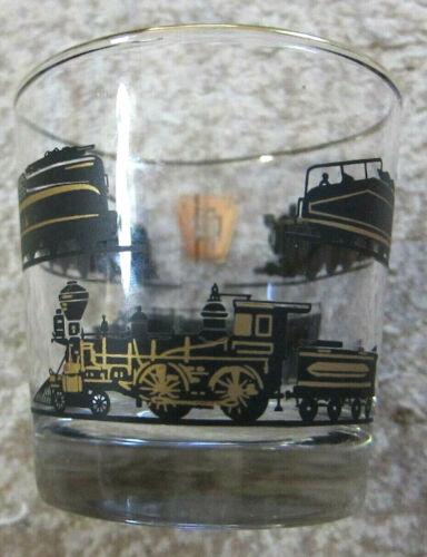 Pennsylvania Railroad gold-rimmed glass tumbler features various trains...