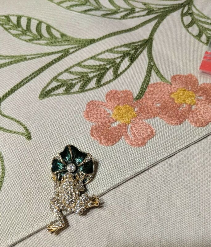 Enamel & Swarovski Crystal Frog hanging from a Lily Pad Pendant