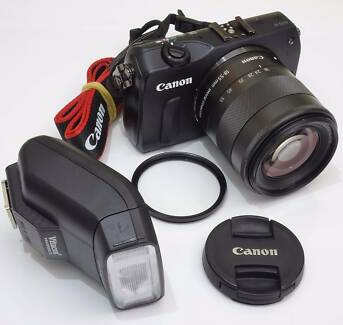 AS NEW Canon EOS M mirrorless camera 18-55 lens, flash.