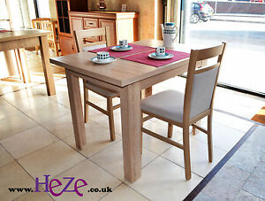 Solid, small size, kitchen or dining table, lovely light oak colour, extending