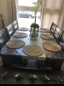 Dining table with 6 chairs and a bench.