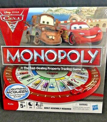 (MONOPOLY Disney Pixar Cars 2 Lightning McQueen Racetrack Board Game Hasbro NIB)