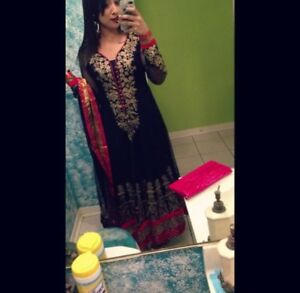 Red and blue Indian outfit. Suit