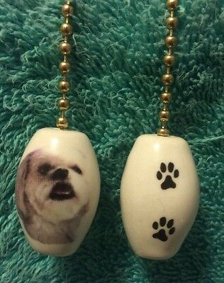 One Lhasa Apso Fan Pull With Paw Prints On The Back 1""