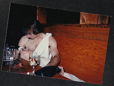 Vintage Photograph Woman Laying on Man's Lap in Diner - Wearing Togas