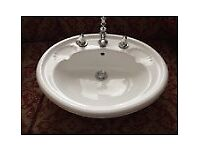 Pair of pretty retro vanity basins with shell soap recesses