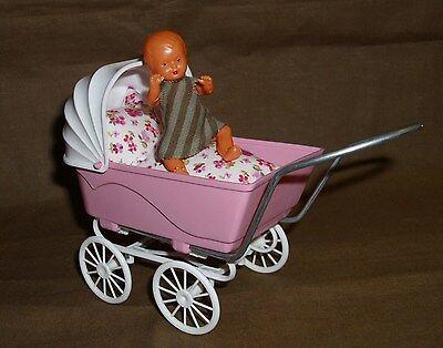 schöner Puppenwagen mit einem Babypüppchen - unbedingt ansehen! -4-