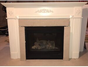 Heat n Glo gas fireplace with mantel and marble inserts