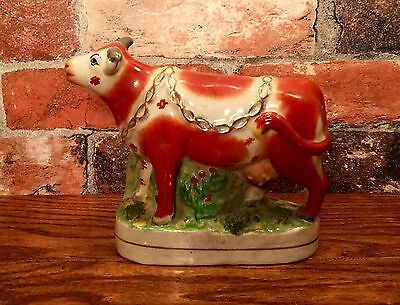 Staffordshire Red & White Cow with Floral Bocage Porcelain Figurine