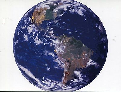 POST CARD OF A VIEW OF EARTH FROM OUTER SPACE