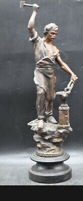 A Patinated Spelter Sculpture of a Blacksmith, early 20th Century on Wood Plinth
