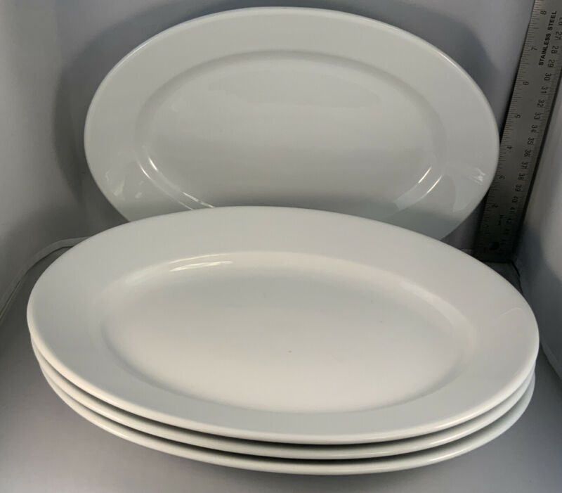 Set Of 4 Apilco #11 White Porcelain Oval Chop Plates