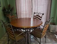 dining table, chairs and bakers rack