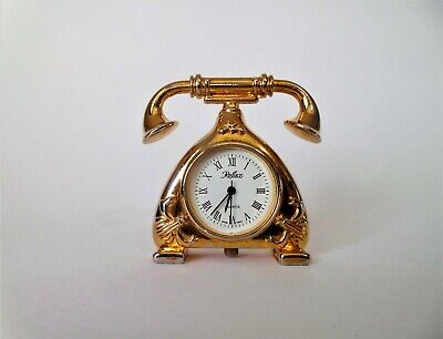 A vintage old fashioned telephone brass ornament with quality miniature clock