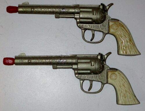 (2) Hubley Cap Pistols mounted on an old lamp - all items in good condition