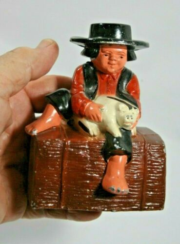 "Vintage Cast Iron Amish Boy with Pig on Hay Bale Coin Bank, 4.5"" Tall"