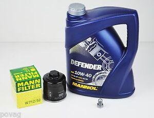 MANN Ölfilter VW Golf 3 Polo 6N 86C + 5 Liter Mannol SAE 10W-40 Defender Motoröl