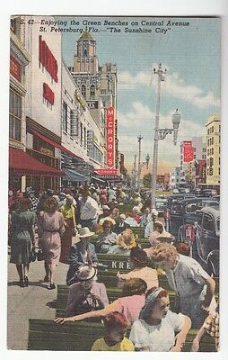 [49557] 1948 POSTCARD GREEN BENCHES ON CENTRAL AVENUE IN ST. PETERSBURG, FLORIDA