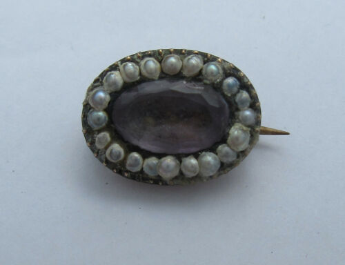 19th Century Yellow Metal Oval Brooch Set Seed Pearls Around Central Amethyst